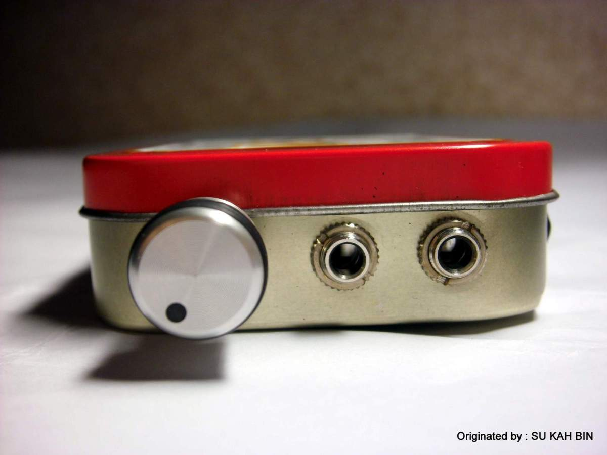 Front view of it,a volume knob at left side,input at the middle and headphone jack at left side.