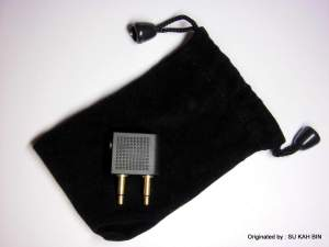 Earphone pouch and airplane adapter is included as well.