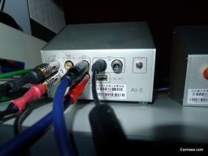 Custom Made speaker cables by Black Octagon Solution plugged into the amplifier unit